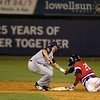 The Lowell Spinners CJ Chatham is tagged out as he slides into second by Michael Paez of the Brooklyn Cyclones during Monday nights game. SUN/JOHN LOVE