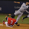 The Lowell Spinners Chris Madera slides into second as the throw to Michael Paez of the Brooklyn Cyclones ius just wide during Monday nights game. SUN/JOHN LOVE