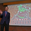 Owner of the Lowell Spinners Dave Heller shows off the new team logo at an  unveiling ceremony in the Clark Auditorium at Lowell General Hospital on Wednesday morning. SUN/JOHN LOVE