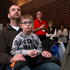 The Lowell Spinners held an unveiling their new logo during a ceremony in the Clark Auditorium at Lowell General Hospital on Wednesday morning February 1, 2017.Watching the uneiling of the new logo is Ryan Reveley the Spinners Chaplin and his son Shepherd Reveley, 6, both from Chelmsford. SUN/JOHN LOVE