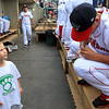 The Lowell Spinners opening day was on Monday afternoon, June 19, 2017, at LeLacheur Park. Spinner Ryan Oduber signs a ball for Dimitri Speros, 5, in the dugout just before the game. SUN/JOHN LOVE