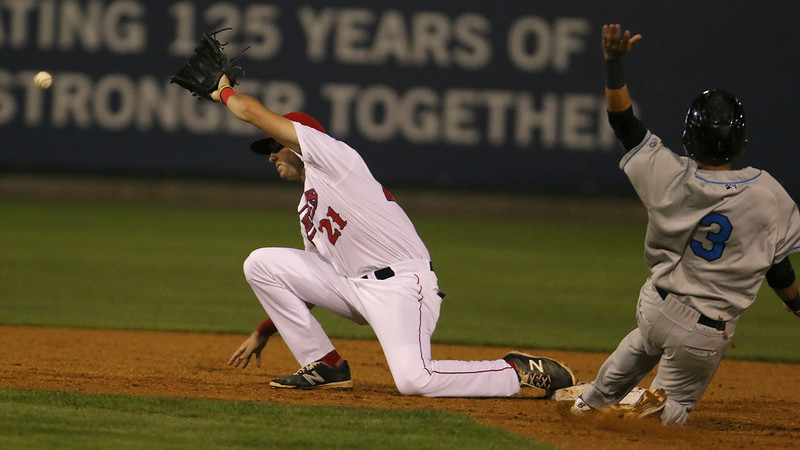 The Lowell Spinners in playoff action vs. the Hudson Valley Ray's on Wednesday night in Lowell. Ray's player Bill Pujois slides safe into second as Spinners player Joe Serrapica gets a bad through from first during action in the game. SUN/JOHN LOVE