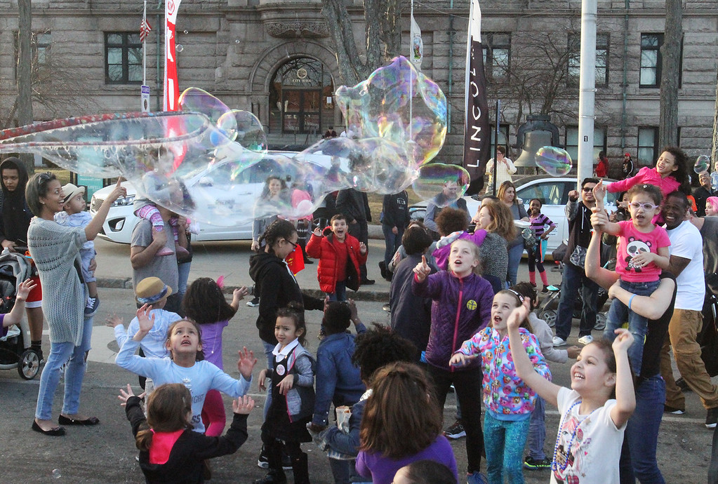 . Kids try to reach big bubbles being released at 2017 Lowell Winterfest Saturday.  (SUN/Julia Malakie)