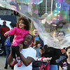 2017 Lowell Winterfest Saturday. Faith Fox, 4, with her father Duane Fox of Lowell, enjoys the big bubbles.  (SUN/Julia Malakie)