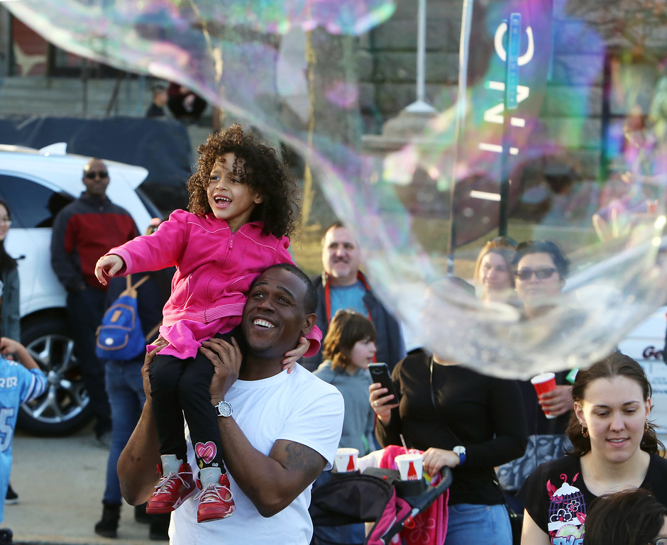. 2017 Lowell Winterfest Saturday. Faith Fox, 4, with her father Duane Fox of Lowell, enjoys the big bubbles.  (SUN/Julia Malakie)