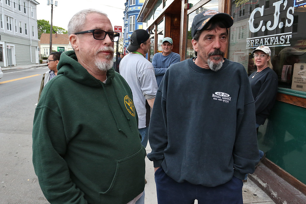 . Jay Carrigher of Pelham and Brendan Wilcox of Nashua, who was from Lowell, talk about the seach for Ross Elliott of Lowell who was a suspect in the killing of  a women early Thursday morning in the Highland area of Lowell. SUN/JOHN LOVE