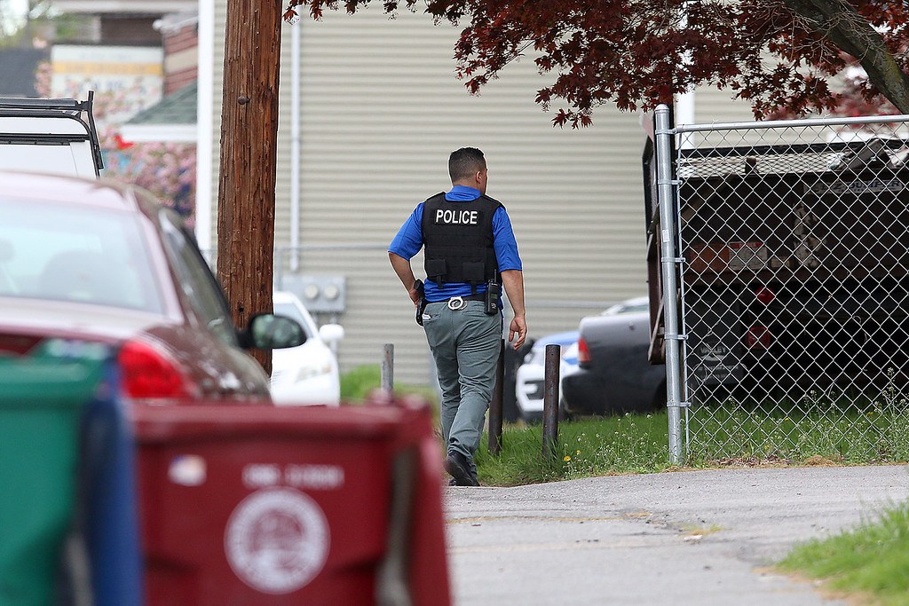 . There was a search through the Highlands area of Lowell for Ross Elliott of Lowell who was a suspect in the killing of  a women early Thursday morning . SUN/JOHN LOVE