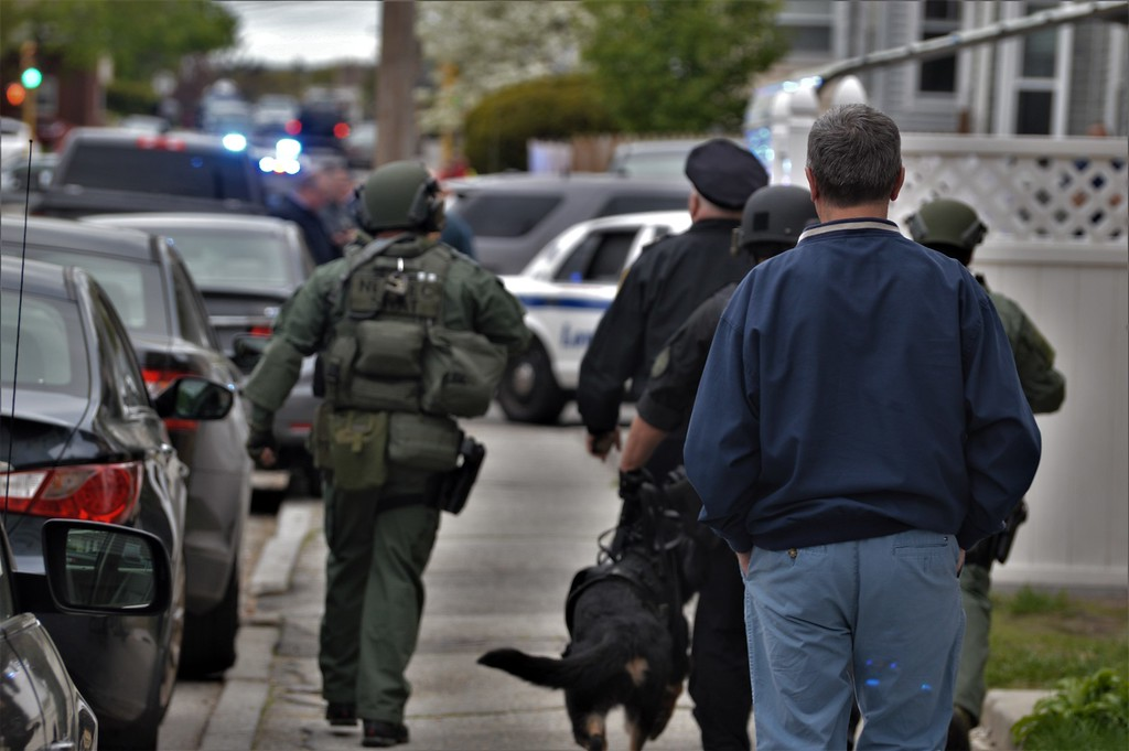 . Local law enforcement agencies searching Highlands section of Lowell for murder suspect Ross Elliott. Photo by Mikhail Higley.
