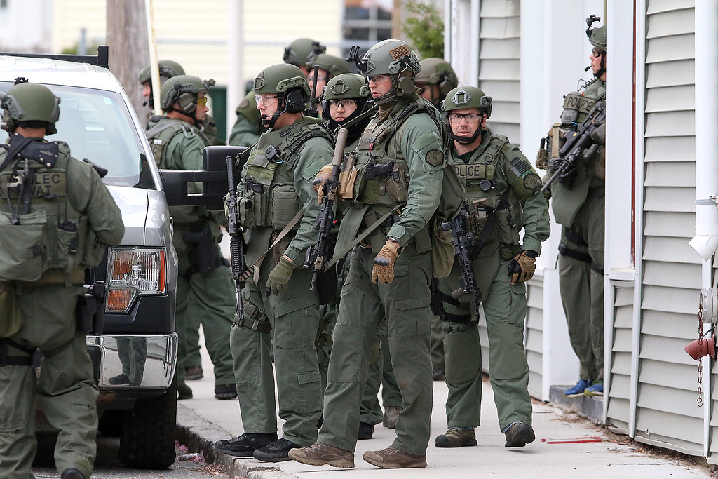 . Members of the North Eastern Massachusetts Law Enforcement Council (NEMLEC) just finished going through a building at the corner of Westford and Pine Street in Lowell as they searched for Ross Elliott of Lowell who was a suspect in the killing of a women early Thursday morning. SUN/JOHN LOVE