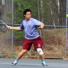 Lowell second singles player Hai Nguyen returns the ball to his opponent from Lawrence on Monday afternoon. SENTINEL& ENTERPRISE/JOHN LOVE