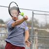 Lowell first singles player Hao  Nguyen returns the ball to his opponent from Lawrence on Monday afternoon. SENTINEL& ENTERPRISE/JOHN LOVE