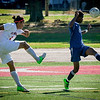 At left, Lowell's Wesad Al-Saadi kicks the ball up and awat from Medford player, Curtis Brown. SUN/Caley McGuane