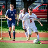 Lowell's Damon Deocleciano runs with the ball with Medford player, Owen Miller close behind. SUN/Caley McGuane
