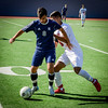 At left, Medford's Joe Moreira and Lowell's Joao Desouza go after the ball. SUN/Caley McGuane
