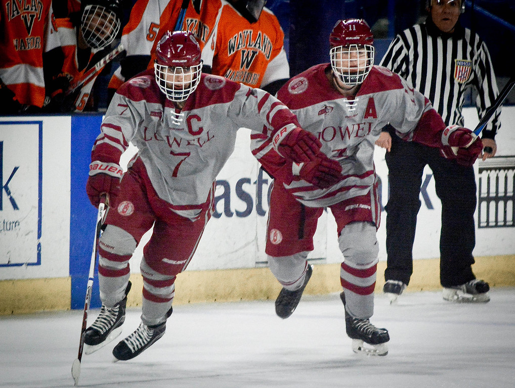 . At left, Lowell\'s Captain Caset Sheehy doesnt let his diabetes stop him from playing hockey as he races down the rink with his teammate Tyler Doucette right behind him in their game against Wayland. SUN/Caley McGuane