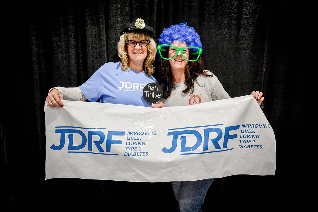 . From left, Angela Kotsifas of Lowell and Colleen Asselin of Lowell have fun with the photo booth at the Fight Against Diabetes fundraiser before the Lowell vs. Wayland hockey game. SUN/Caley McGuane