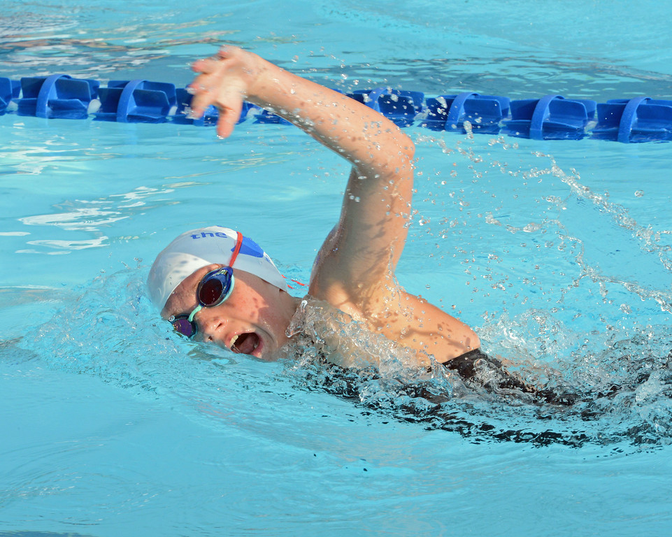 . Mary Kate Leonard churns through the waters in LBSL championships.