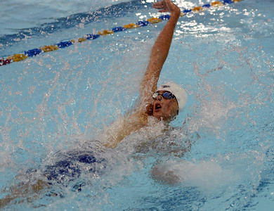 Mark Disbrow reaches out in backstroke at LBSL championships.