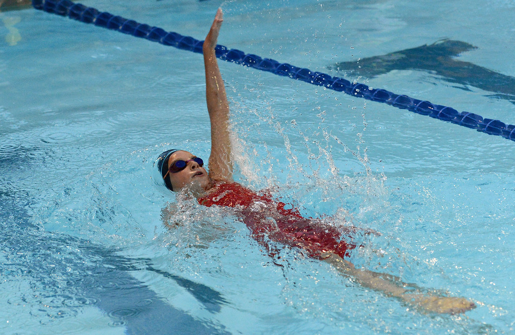. Emily Peifer shows good form in the 100 backstroke event.