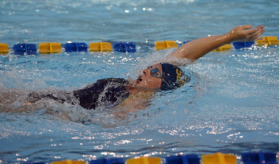 Jessica Magee swims the 100 backstroke in Lower Bucks Swim League championships.