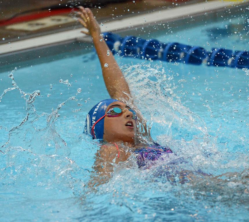 . Jordyn Popowicz gets set to make turn in 50 backstroke.
