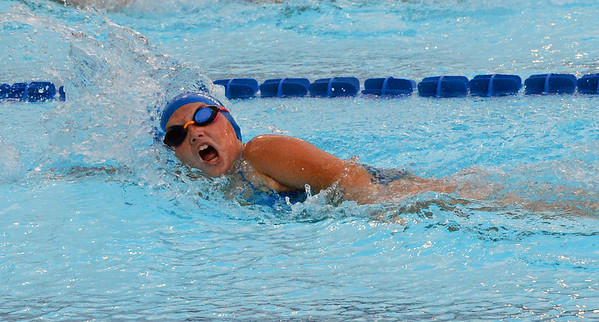 Lilly Jachimski swims leadoff leg for mixed relay team.