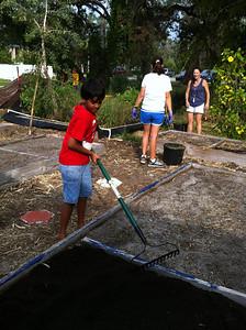 Arnav preparing the new soil for planting
