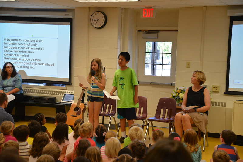 Ali R. '23 and Sam W. '23 lead the Closing Assembly