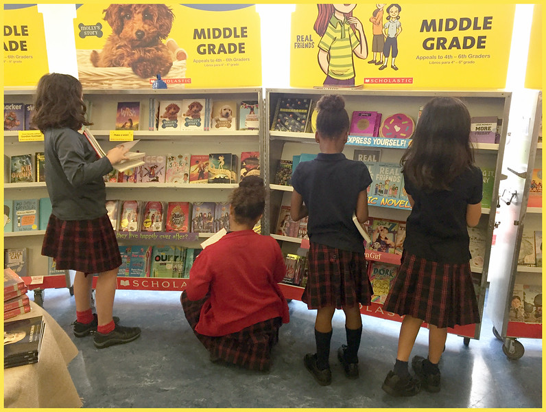 Some of the girls of 3M perusing the books
