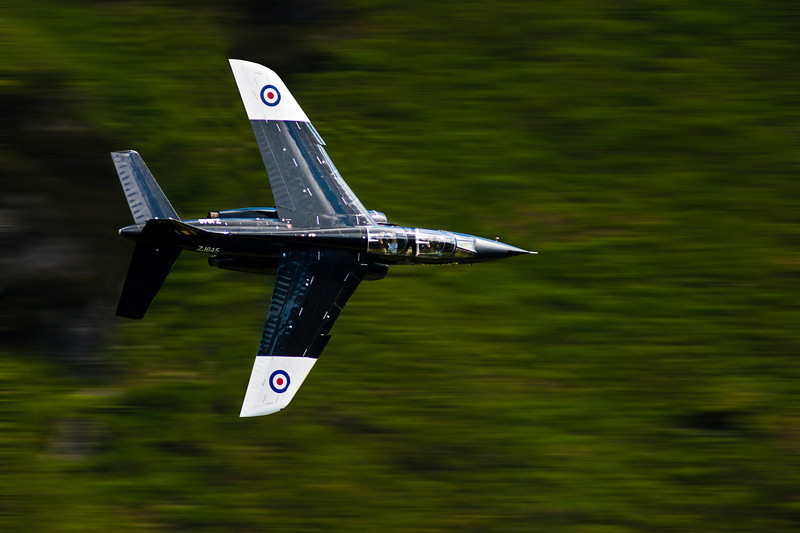 This was my first low level jet taken with a canon 300mm F4L and my canon 40D, If you look at the pilot in the rear you can see he is reading a map. This jet was moving at about 400-500 mph. Taken in Wales Uk.