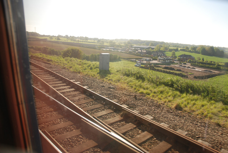 These Next 15 pictures although taken through the window and not <br /> <br /> exactly great. <br /> <br /> I have tried to give people some idea of what it like when you arrive <br /> <br /> at Frodsham Jct<br /> <br /> And cross over onto the Halton curve. <br /> <br /> The above shows the rear coach of 150 271 crossing from the main <br /> <br /> line and over / across onto Frodsham Jct and onto the Halton curve <br /> <br /> / Frodsham Link and the actual Parliamentary bit of track that <br /> <br /> people come from all the country for <br /> <br /> <br /> The track going away to the right heads for the Frodsham Goods <br /> <br /> Loop just across from the signal box and Runcorn East Station which <br /> <br /> is about another 2 ish miles up the line