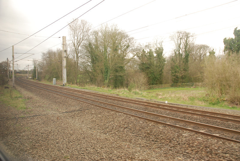 The next set of pictures show the line from the Train Window each <br /> <br /> Jct and on the Curve at Lowton Jct etc so as to give you some idea <br /> <br /> of the route they where taken both on my Compact on one trip and <br /> <br /> with my big D80 SLR on the return trip but they do tell the story of <br /> <br /> this little used Parliamentary route enjoy:<br /> <br /> Route:<br /> <br /> After leaving Wigan North Western the train goes straight down the <br /> <br /> WCML until it gets here this is the start of the Parliamentary bit:<br /> <br /> Location: <br /> <br /> Golbourne Jct <br /> <br /> The West Coast Mainline to Warrington Bank Quay / Crewe / <br /> <br /> London etc goes straight on here to the right as the train goes Left <br /> <br /> onto Golbourne Jct.
