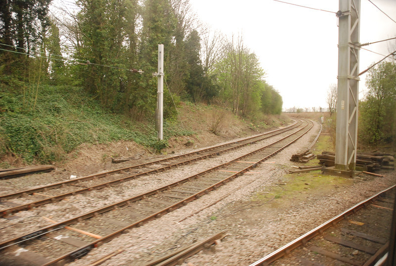 Location: Lowton Jct <br /> <br /> here we see the train curving round to the right hand side of the <br /> <br /> Triangle while the route to the left going away goes to Parkside Jct <br /> <br /> the route via Parkside is the more Rarer route due to there being no <br /> <br /> actuall booked passenger trains to run via Parkside Jct although it <br /> <br /> was available for a Weekend during the end of Oct 2011 so i took <br /> <br /> advantage to get it in.
