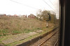 Lowton Station platform <br /> <br /> Siganl # WN 515 with a feather route Indicator for the Left hand side <br /> <br /> of the triangle that comes out at Parkside Jct