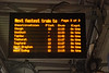 Shot of the Departure board on the platform showing trains to various destinations except ours