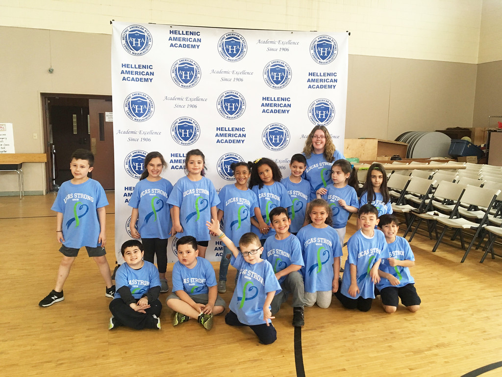 . Lucas and his fellow first-graders with teacher Amanda Rollins of Woburn