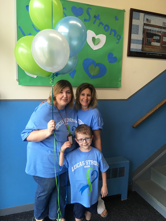 . Lucas with teachers Maria Booras of Lowell, left, and Laurie Archambault of Dracut
