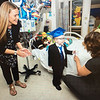 A courtesy photo of Lucas receiving his diploma from HAA teachers while recovering at Boston Children's Hospital.