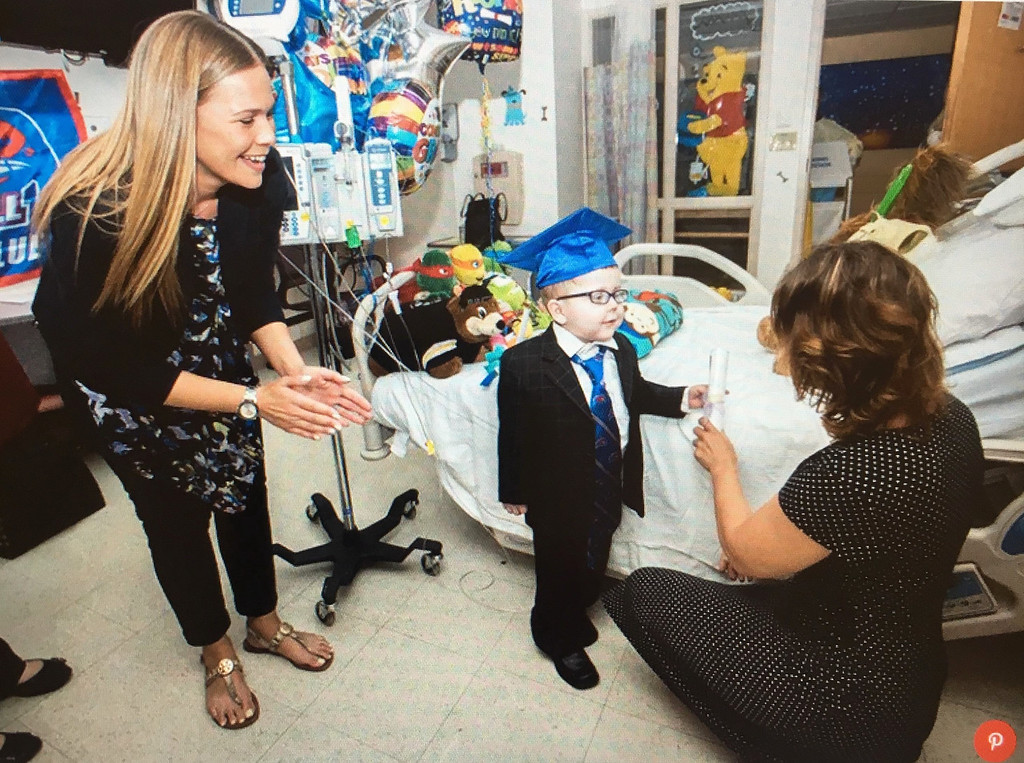 . A courtesy photo of Lucas receiving his diploma from HAA teachers while recovering at Boston Children�s Hospital.