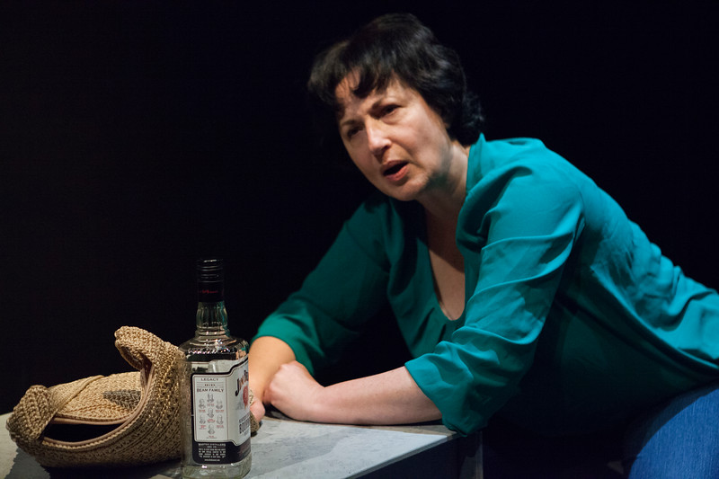 Jeri Lynn Cohen.   Alone with a bottle.  Word for Word's Lucia Berlin: Stories; photo credit, Julie Schuchard