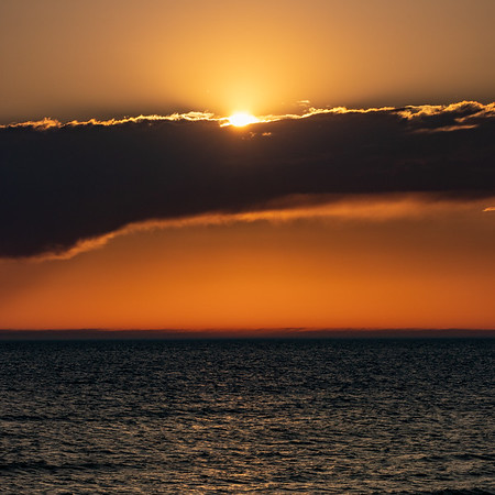 Sunset Behind the Clouds in Ludington