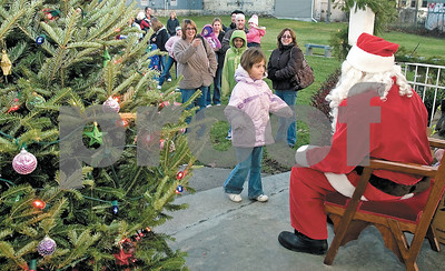 Andrew Skinner ¥ÊOceanaÕs Herald-Journal Valerie Belleck, 5, of St. Clair Shores, was the first child to visit with Santa during his visit to the Pentwater Village Green Saturday, Nov. 28.