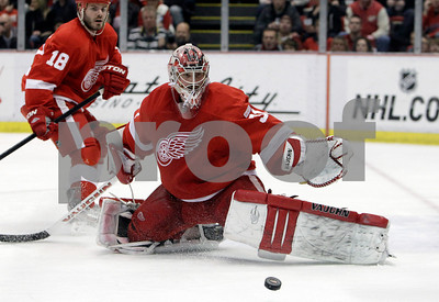 Detroit Red Wings goalie Joey MacDonald (31) deflects a shot during the second period of an NHL hockey game against the Los Angeles Kings in Detroit, Friday, March 9, 2012. (AP Photo/Carlos Osorio)
