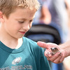 PETE BANNAN-DIGITAL FIRST MEDIA  Zachary Tomlinson,9, looks at a White's tree frog from Australia held by Phil Witman at the Ludwig's Corner Horse Show and Country Fair Monday.