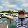 Elijah has his picture taken after the boat is docked