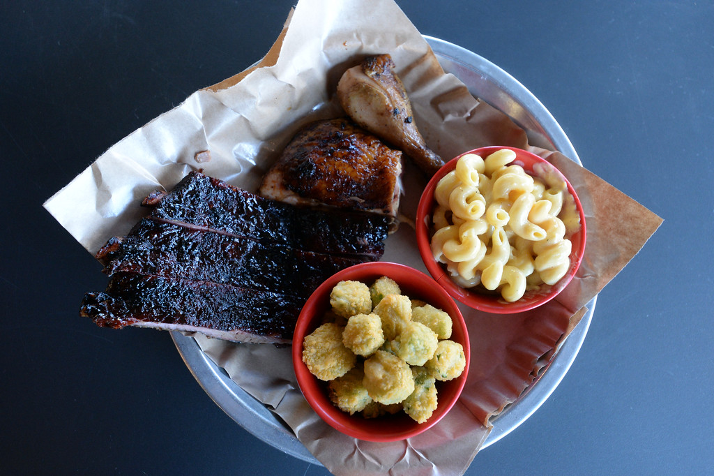 . The two meat combo plate with chicken, ribs, fried okra, and mac and cheese at Lulu\'s BBQ in Louisville.  Cliff Grassmick  Photographer December 15, 2017
