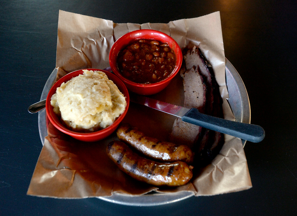 . The  2 meat combo plate with brisket, sausage, mashed potatoes, and pit beans at Lulu\'s BBQ in Louisville.  Cliff Grassmick  Photographer December 15, 2017