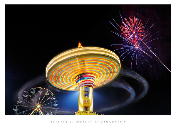Out of This World Fourth of July Fun! July 3, 2008  This image was captured Friday evening at the Webster Groves Community Days.  This not the same as the one I posted two days ago.  I took over 50 images at this one spot. It took me a while to figure out exactly where to get what I wanted. When I finally got there, I camped out until I got the image I was looking for. There's a little photoshop magic here, but not as much as you might think.