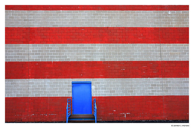 Flag Wall Nikon D80 with 18-200 at 20mm (f10, 1/100, ISO 200) December 11, 2006 This can be found on the north side of Route 66 (Watson Rd.) in Crestwood, MO.  Shot this yesterday when I noticed it driving by the building in the afternoon.  After correcting for lens distortion, I wasn't sure why I was getting the wavy lines in the bricks.  So I made a trip back to the wall to try to retake the shot.  Well, the wall itself was not straight, so I didn't bother to capture another image.