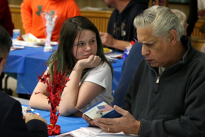 Samoset Middle School in Leominster held lunch with veterans on Thursday, November 9, 2017. Sixth grader Anya Levine watches as her Grandfather Army veteran First Sgt. Owen Levine reads a card she made for him during the lunch. SENTINEL & ENTERPRISE/JOHN LOVE